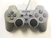 [PS1] Drôtový Ovládač Sony Dualshock - sivý (žltkastý)