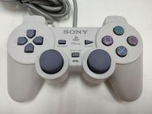 [PS1] Drôtový Ovládač Sony Dualshock - biely (rôzne estetické vady)