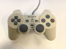 [PS1] Drôtový Ovládač Sony Dualshock - biely (žltkastý) (estetická vada)